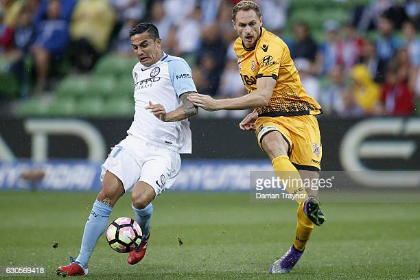 Tim Cahill of Melbourne City and Rostyn Griffiths of Perth Glory compete during the round 12 ALeague match between Melbourne City and Perth Glory at...