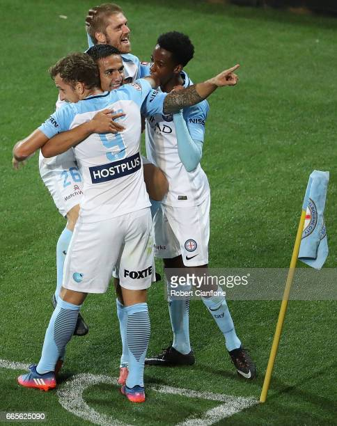 Tim Cahill of Melbourne City celebrates Nicolas Colazo after scoring a goal during the round 26 ALeague match between Melbourne City FC and Adelaide...