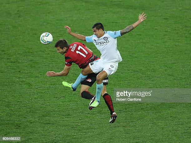 Tim Cahill of Melbourne City challenges Artiz Borda of the Wanderers during the FFA Cup Quarter Final between Melbourne City and Western Sydney at...