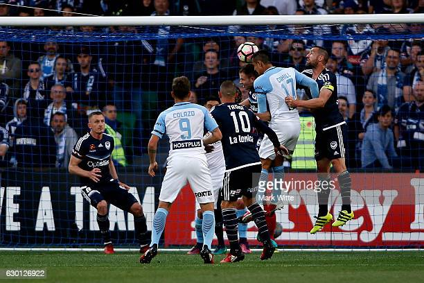 Tim Cahill of Melbourne City heads a goal during the round 11 ALeague match between Melbourne City FC and Melbourne Victory at AAMI Park on December...