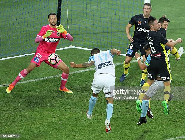 Tim Cahill of Melbourne City heads the ball past Mariners goalkeeper Paul Izzo during the round 16 ALeague match between Melbourne City FC and the...