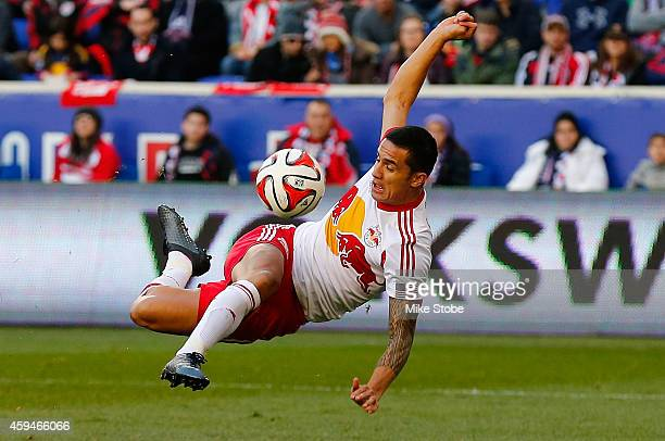 Tim Cahill of New York Red Bulls takes a shot at the goal against the New England Revolution during the Eastern Conference Final - Leg 1 at Red Bull...