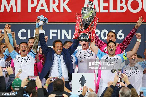 Tim Cahill of the City City head coach John van't Schip and Bruno Fornaroli of the City lift up the FFA Cup after winning during the FFA Cup Final...