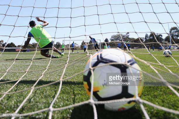 Tim Cahill of the City fails as goal keeper against City goalkeeper Dean Bouzanis who takes a penalty kick during a Melbourne City ALeague training...