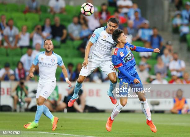 Tim Cahill of the City heads the ball over John Koutroutmbis of the Jetsfor a goal during the round 23 ALeague match between Melbourne City FC and...