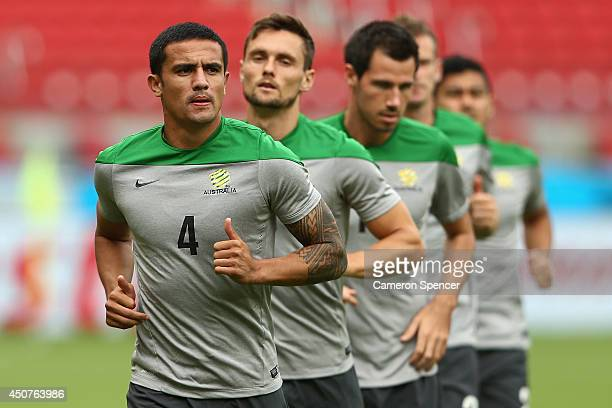 Tim Cahill of the Socceroos and team mates run during an Australian Socceroos training session and press conference at Estadio BeiraRio on June 17...