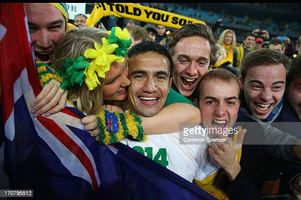 Tim Cahill of the Socceroos celebrates with fans after winning the FIFA 2014 World Cup Asian Qualifier match between the Australian Socceroos and...