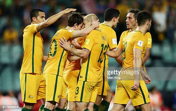 Tim Cahill of the Socceroos celebrates with Robbie Kruse and Aaron Mooy after scoring his second goal during the 2018 FIFA World Cup Qualification...