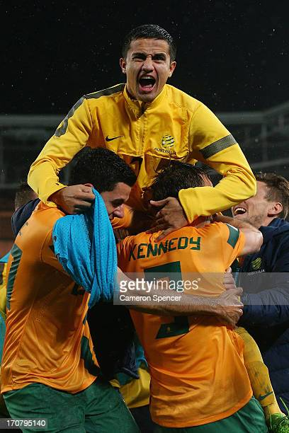 Tim Cahill of the Socceroos celebrates with team mate Josh Kennedy after Kennedy scored a goal during the FIFA 2014 World Cup Asian Qualifier match...