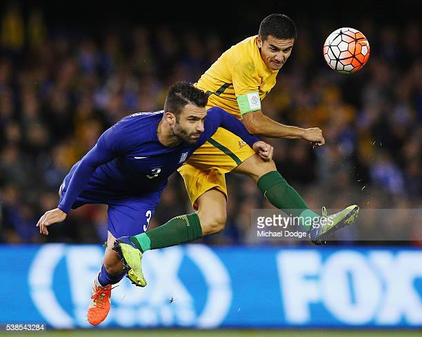 Tim Cahill of the Socceroos heads the ball against Giorgios Tzavellas of Greece during the International Friendly match between the Australian...