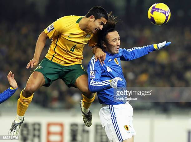 Tim Cahill of the Socceroos leaps over Marcus Tulio Tanaka of Japan to head the ball during the 2010 FIFA World Cup Asian qualifying match between...