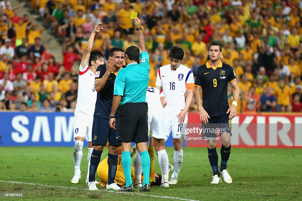 Tim Cahill of the Socceroos receives a yellow card during the 2015 Asian Cup match between Australia and Korea Republic at Suncorp Stadium on January 17, 2015 in Brisbane, Australia.