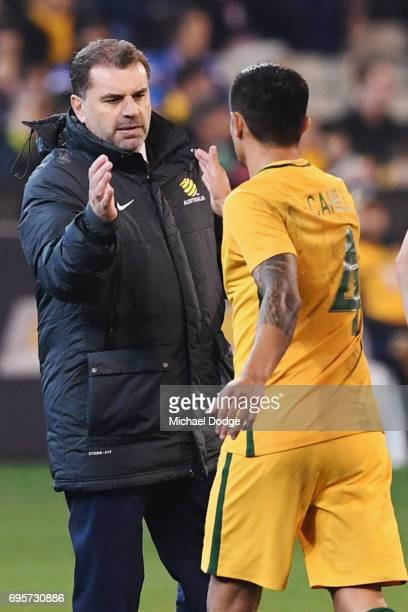 Tim Cahill of the Socceroos shakes hands with Socceroos head coach Ange Postecoglou after coming off during the Brasil Global Tour match between...