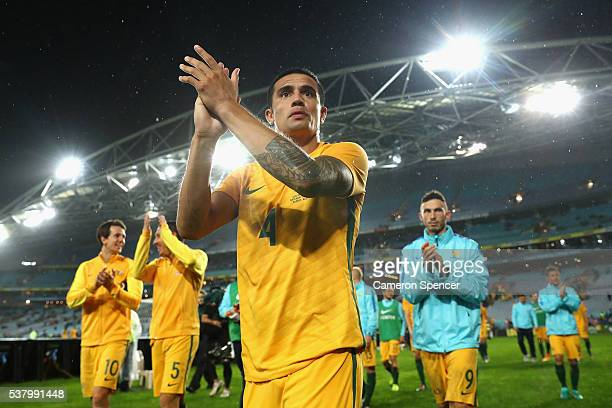Tim Cahill of the Socceroos thanks fans after winning the international friendly match between the Australian Socceroos and Greece at ANZ Stadium on...