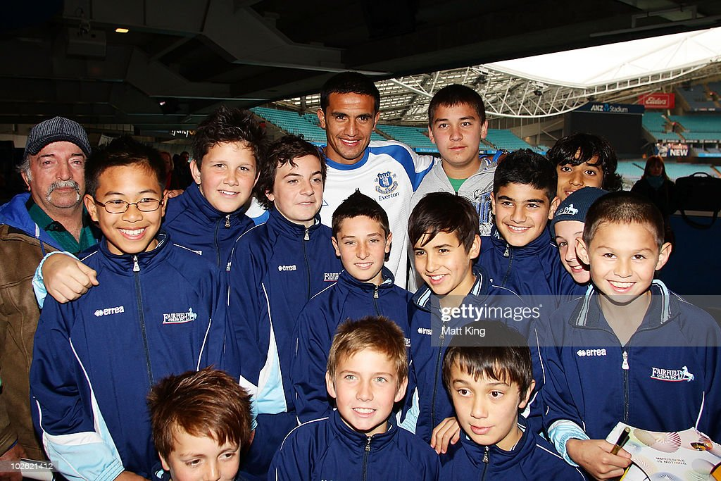 Tim Cahill poses with young fans during an Everton FC press conference at ANZ Stadium on July 5, 2010 in Sydney, Australia.