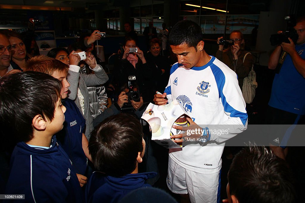 Tim Cahill signs autographs during an Everton FC press conference at ANZ Stadium on July 5, 2010 in Sydney, Australia.