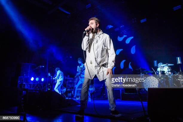 Tim Carter Sergio Pizzorno Tom Meighan and Ian Matthews of Kasabian perform live on stage during a concert at Columbiahalle on October 31 2017 in...