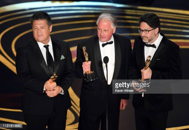 Tim Cavagin Paul Massey and John Casali accept the Sound Mixing award for 'Bohemian Rhapsody' onstage during the 91st Annual Academy Awards at Dolby...