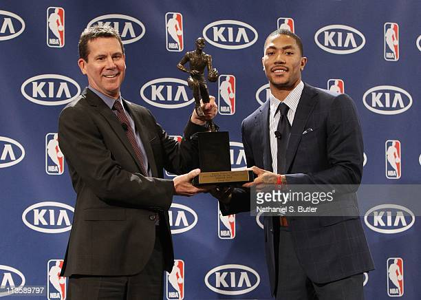 Tim Chaney gives Derrick Rose of the Chicago Bulls the 201011 Kia NBA Most Valuable Player Award on May 3 2011 in Lincolnshire Illinois NOTE TO USER...