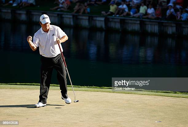 Tim Clark of South Africa celebrates his fiveunderpar 67 on the 18th hole after completing the final round of THE PLAYERS Championship held at THE...
