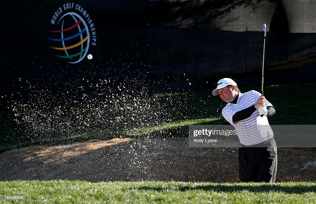 Tim Clark of South Africa hits his second shot on the par 3 12th hole during the third round of the World Golf Championships - Accenture Match Play against Ian Poulter of England at the Golf Club at Dove Mountain on February 23, 2013 in Marana, Arizona.