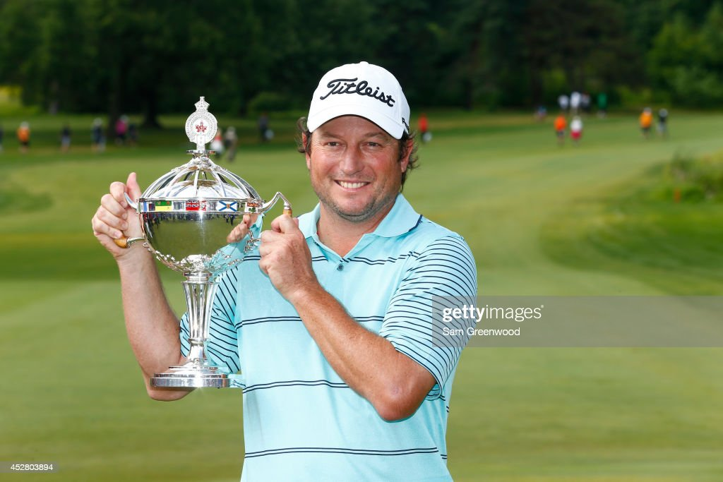Tim Clark of South Africa holds the trophy after winning the RBC Canadian Open at the Royal Montreal Golf Club on July 27, 2014 in Montreal, Quebec, Canada.