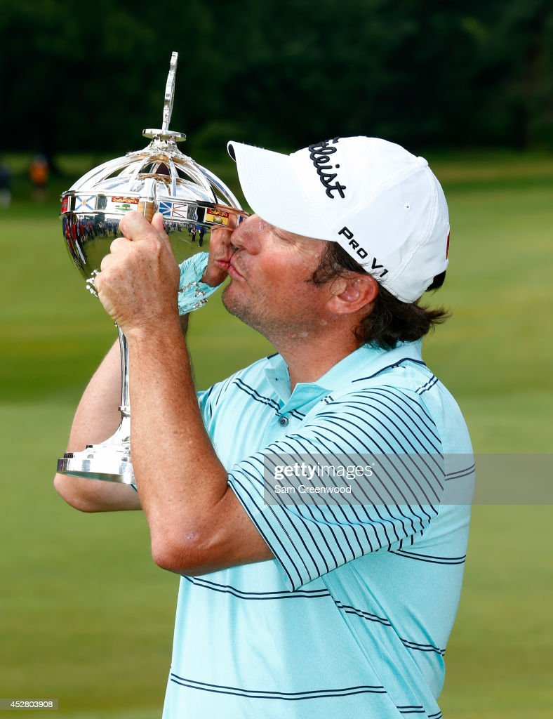 Tim Clark of South Africa kisses the trophy after winning the RBC Canadian Open at the Royal Montreal Golf Club on July 27, 2014 in Montreal, Quebec, Canada.