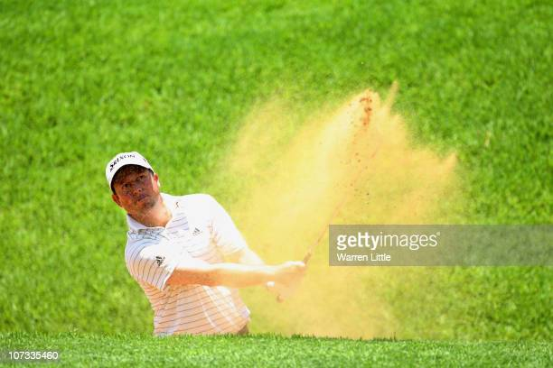 Tim Clark of South Africa plays out of the seventh greenside bunker during the final round of the 2010 Nedbank Golf Challenge at the Gary Player...