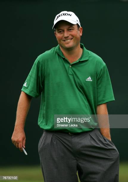 Tim Clark of South Africa smiles after finishing his round on the 18th hole during the first round of the TOUR Championship at East Lake Golf Club on...