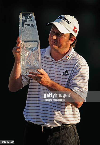 Tim Clark of South Africa smiles while holding the trophy after winning THE PLAYERS Championship held at THE PLAYERS Stadium course at TPC Sawgrass...