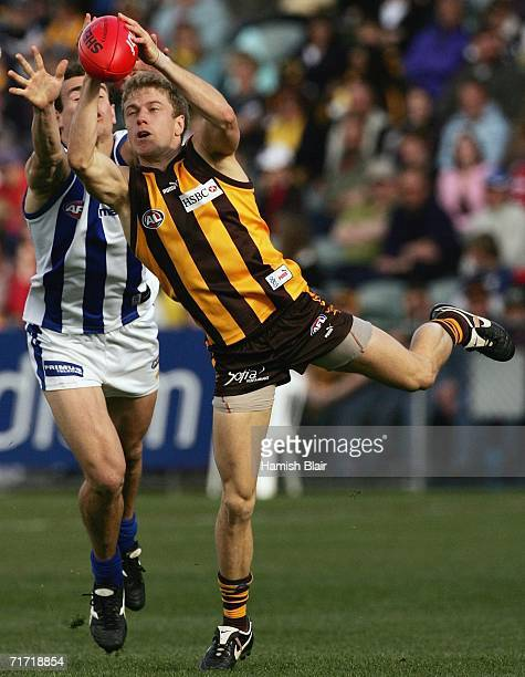 Tim Clarke for Hawthorn marks in front of Corey Jones for the Kangaroos during the round 21 AFL match between the Hawthorn Hawks and the Kangaroos at...