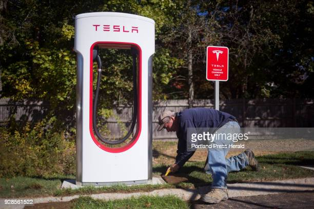 Tim Cleaves puts sod around one of the new Tesla Superchargers in the LL Bean parking lot off of Justins Way There are currently 8 Superchargers and...