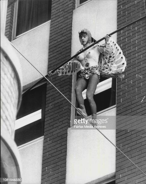Tim Coldwell standing in for Jo Kennedy as Jackie Mullins star of the movie Starstruck walks scores a high wire crossing Loftus Lane off Young St in...
