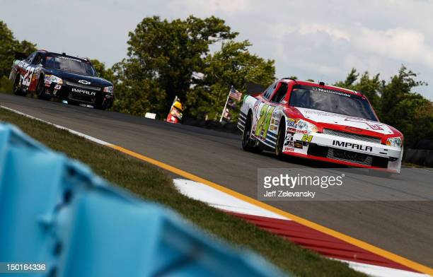 Tim Connolly driver of the Michael Connolly Endowment for Lung Cancer Chevrolet leads Dexter Stacey driver of the R3 Motorsports Chevrolet during the...