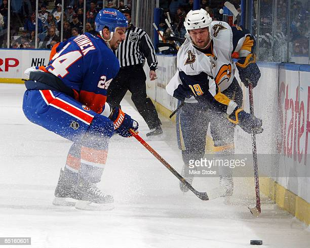 Tim Connolly of the Buffalo Sabres and Radek Martinek of the New York Islanders battle for control of the puck on February 28 2009 at Nassau Coliseum...