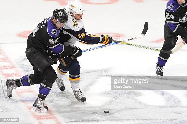 Tim Connolly of the Buffalo Sabres battles for the puck against Teddy Purcell the Los Angeles Kings on January 21 2010 at Staples Center in Los...