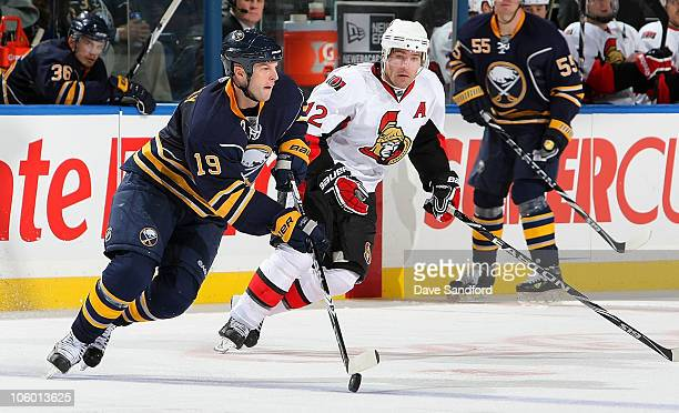 Tim Connolly of the Buffalo Sabres caries the puck as Mike Fisher of the Ottawa Senators defends during their NHL game at HSBC Arena October 22 2010...