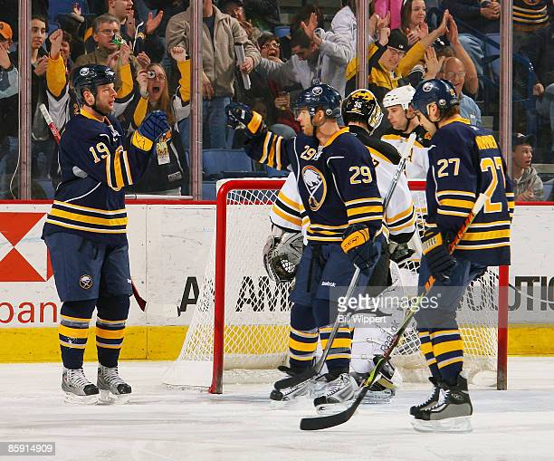 Tim Connolly of the Buffalo Sabres celebrates a first period goal on the Boston Bruins with teammates Jason Pominville and Teppo Numminen on April 11...