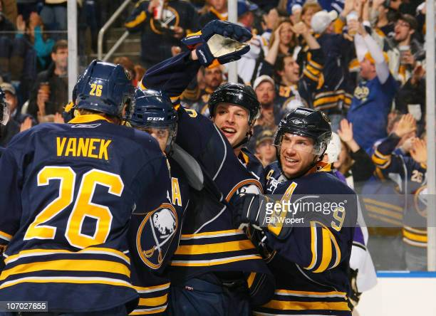 Tim Connolly of the Buffalo Sabres celebrates after scoring the game winning goal against the Los Angeles Kings with teammates Thomas Vanek, Jason...