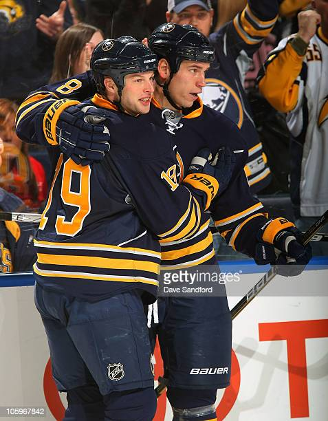 Tim Connolly of the Buffalo Sabres celebrates his 2nd goal of the game against the Ottawa Senators with teammate Cody McCormick during their NHL game...