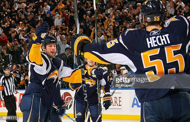 Tim Connolly of the Buffalo Sabres celebrates his goal with teammate Jochen Hecht against the Atlanta Thrashers on January 1 2010 at HSBC Arena in...