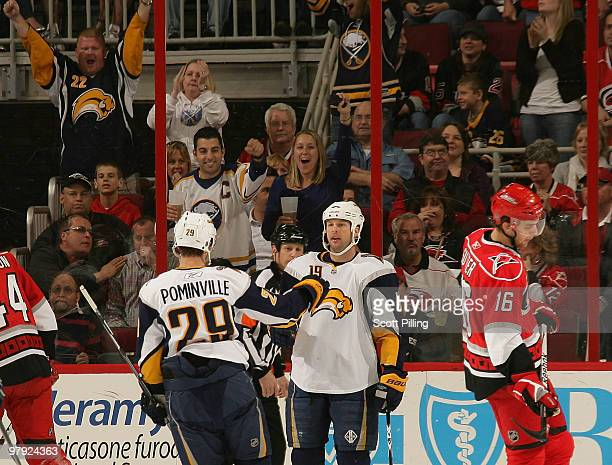 Tim Connolly of the Buffalo Sabres celebrates with teammate Jason Pominville after a goal against the Carolina Hurricanes during their NHL game on...