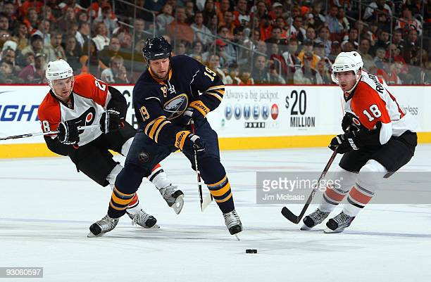 Tim Connolly of the Buffalo Sabres controls the puck against Mike Richards and Claude Giroux of the Philadelphia Flyers on November 14 2009 at...
