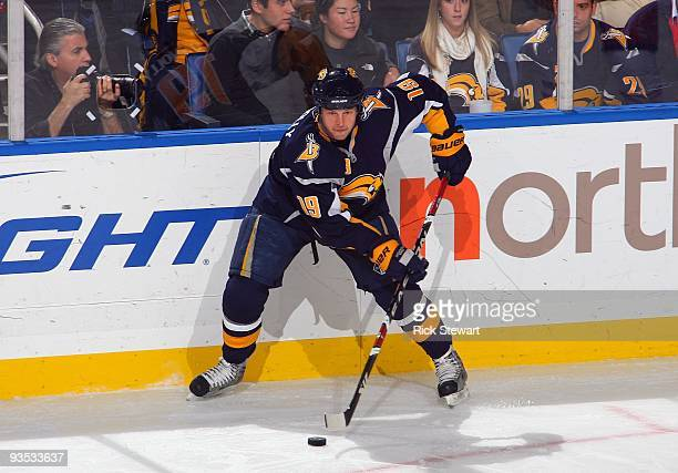 Tim Connolly of the Buffalo Sabres controls the puck near the side boards against the Carolina Hurricanes during their NHL game on November 28 2009...