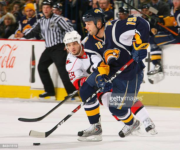 Tim Connolly of the Buffalo Sabres handles the puck against Chad LaRose of the Carolina Hurricanes on January 17 2009 at HSBC Arena in Buffalo New...