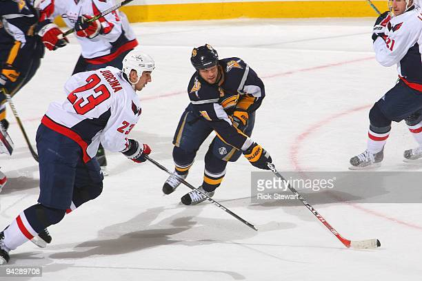 Tim Connolly of the Buffalo Sabres handles the puck against Milan Jurcina of the Washington Capitals on December 9 2009 at HSBC Arena in Buffalo New...