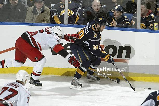 Tim Connolly of the Buffalo Sabres handles the puck against Tim Gleason of the Carolina Hurricanes at HSBC Arena on February 5 2010 in Buffalo New...
