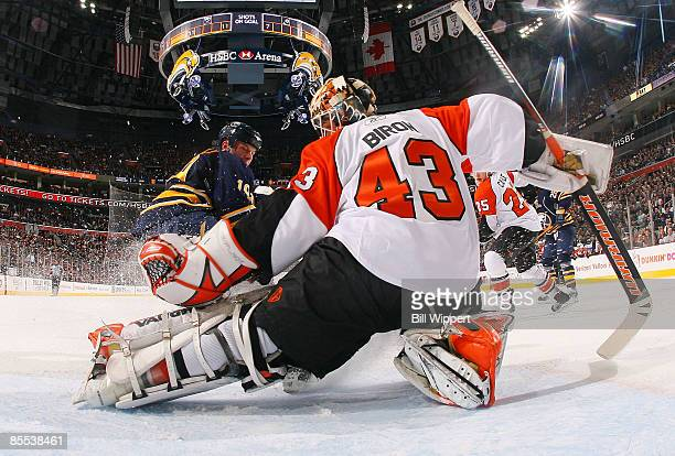 Tim Connolly of the Buffalo Sabres has his shot stopped by Martin Biron of the Philadelphia Flyers on March 20 2009 at HSBC Arena in Buffalo New York