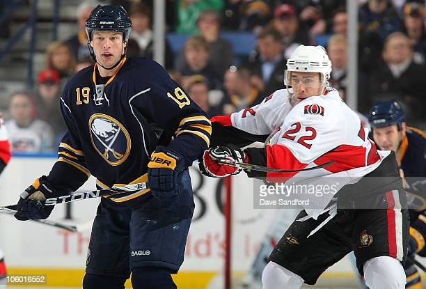 Tim Connolly of the Buffalo Sabres is checked by Chris Kelly of the Ottawa Senators during their NHL game at HSBC Arena October 22 2010 in Buffalo...