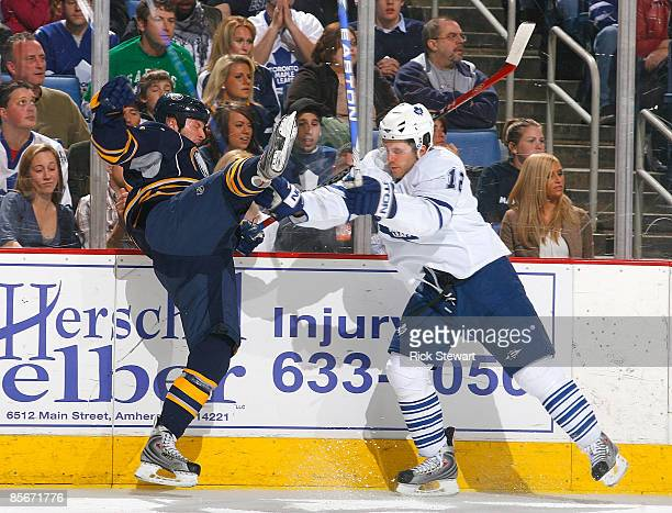 Tim Connolly of the Buffalo Sabres is checked off his feet by Lee Stepniak of the Toronto Maple Leafs on March 27 2009 at HSBC Arena in Buffalo New...